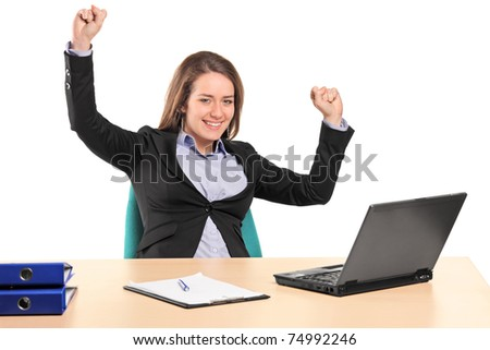 A young happy businesswoman in her office isolated on white background - stock photo