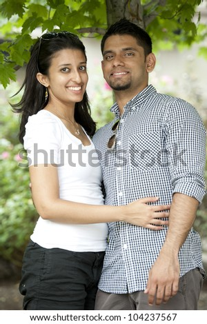 A young happy couple on a beautiful sunny day.