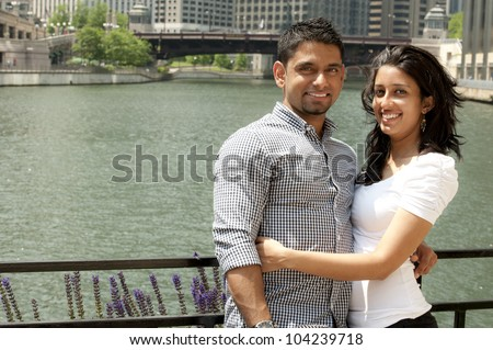 A young happy couple on a bridge. - stock photo