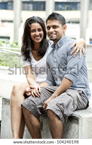 A young happy couple on a sunny day. - stock photo