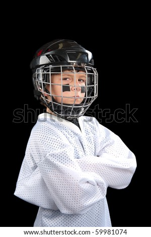 A young hockey player posing with attitude. - stock photo