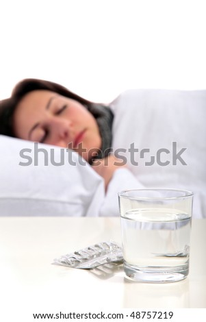 A young ill woman lying in the bed. All on white background.