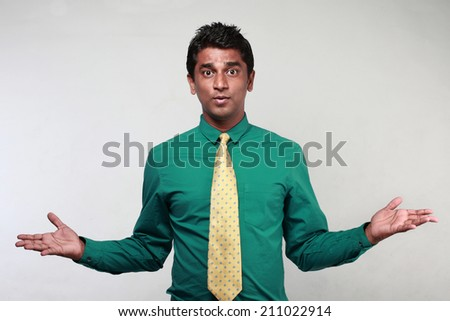 A young Indian business executive in action - stock photo