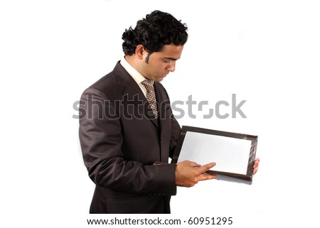 A young Indian businessman checking contract documents, on white studio background. - stock photo