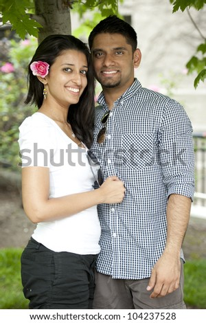 A young Indian couple on a sunny day. - stock photo