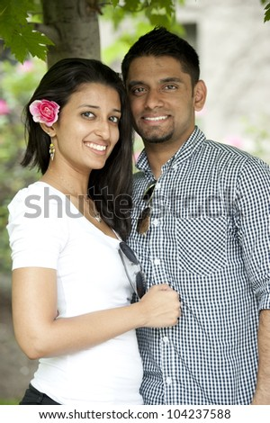 A young Indian couple on a sunny day.
