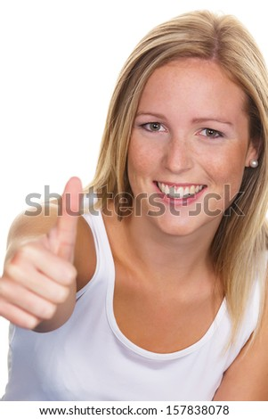 a young, likeable woman holds up her thumb. - stock photo
