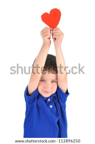 A young little boy is holding a paper cutout of a heart symbol. There is a white isolated background. use it for a love or holiday concept. - stock photo