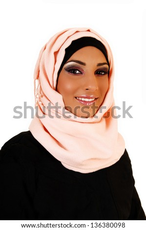 A young lovely teenager girl in a black jacket and a pink headscarf for white background, a portrait shoot of the girl smiling.