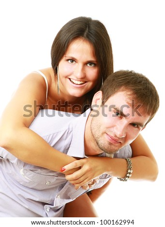 A young loving couple, isolated on white background - stock photo