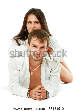 A young loving couple lying on the floor , isolated on white background - stock photo