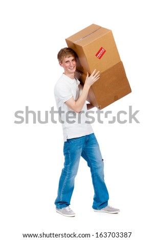 A young male carrying moving boxes on a white background
