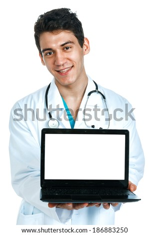 a young male doctor (intern, student) with a laptop computer - stock photo