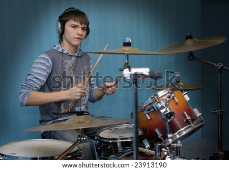 A young male drummer in action