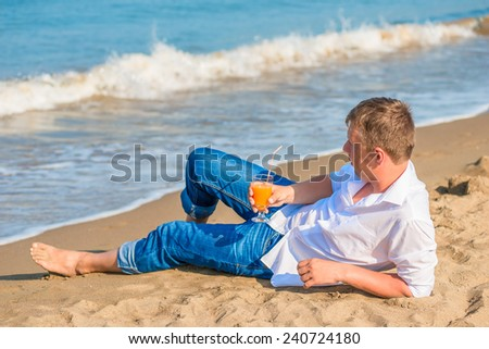 a young male enjoy your vacation on the island - stock photo