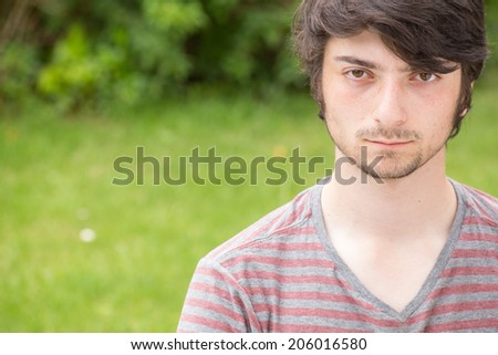 A young male model is serious - stock photo