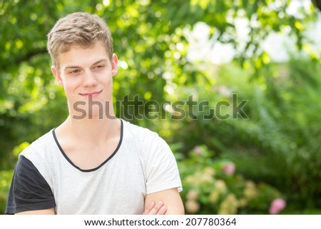 A young male model is smiling down - stock photo