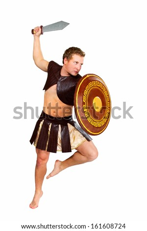 a young male warrior with a shield - stock photo