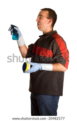 A young male wearing rubber gloves, doing some cleaning, isolated against a white background