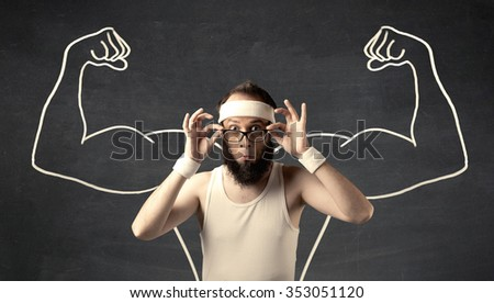 A young male with beard and glasses posing in front of grey background, thinking about lifting weight with big muscles, illustrated by white drawing concept. - stock photo