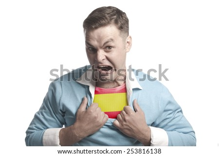 A young man - a patriot: shows the flag of Spain on his chest - stock photo