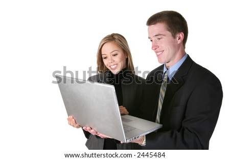 A young man and woman business team holding a laptop computer
