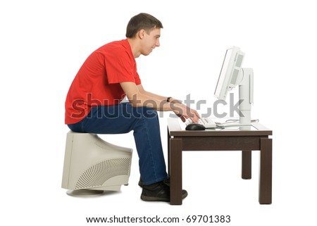 A young man bought a new computer to replace the old. - stock photo