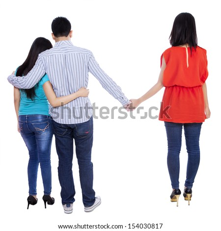 A young man cheating with another woman isolated over white background