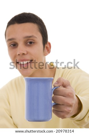 A young man giving you a coffee blue mug (focus on the mug)