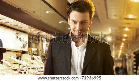 A young man goes shopping with the store