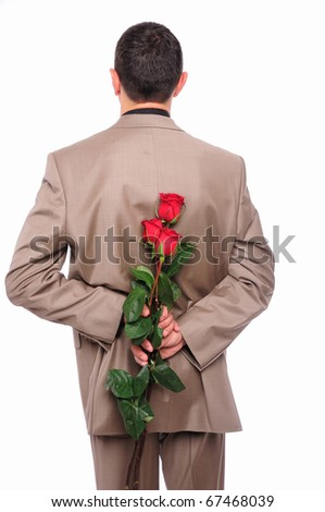 A young man hides behind a rose for his girlfriend in honor of Valentine's Day
