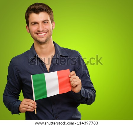 A Young Man Holding A Flag Of Italy On Green Background