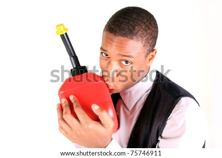 A young man holding a gas can