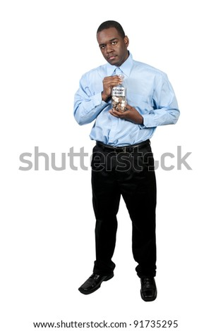 A young man holding a jar of money coins labeled retirement account
