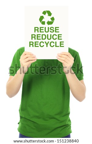 A young man holding a sign with an environmental message  - stock photo