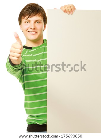 A young man holding empty blank and showing ok, isolated on white background - stock photo