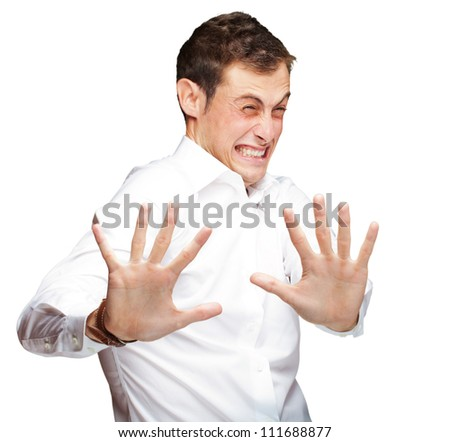 A Young Man Holding His Hands Out In Fear On White Background