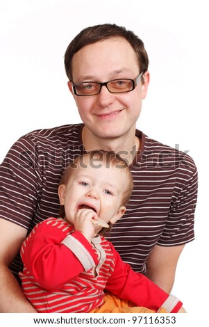 A young man holding his son in his arms on a white background