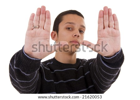 A young man holding up his hand in a stop sign (focus on the head)