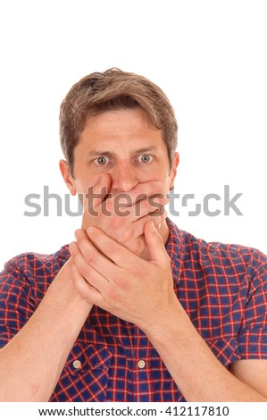 A young man in a closeup image holding his hands over his mouths
