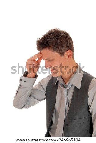 A young man in a grey shirt, tie and vest standing isolated for white