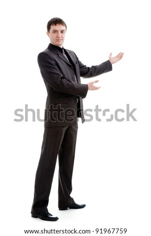 A young man in a suit gestures with his hands, isolated on a white background. - stock photo