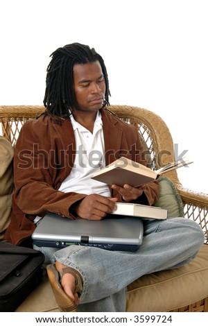 a young man in a waiting area reading a book