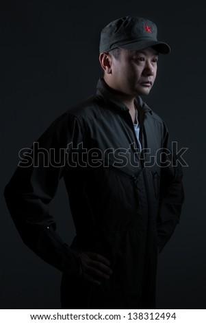 A young man in an Asian military scenario - stock photo