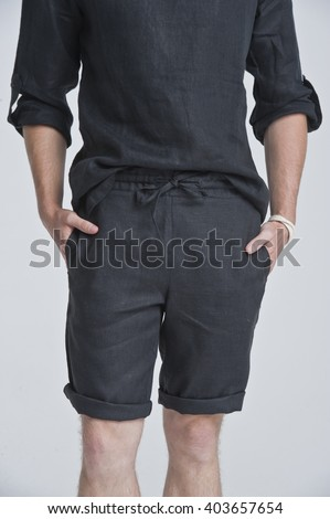 a young man in black clothes, studio shot - stock photo