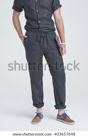 a young man in clothes, studio shot - stock photo