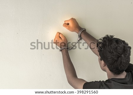 a young man in shackle and leave space for adding your content. background look old or vintage style. (vintage color tone) - stock photo