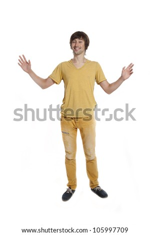 A young man in the yellow tee shirt on a white background in the studio.