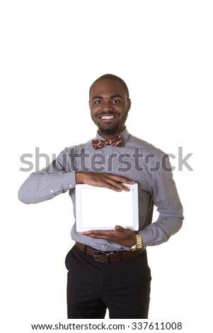 A young man or teenager holding a tablet isolated on white - stock photo