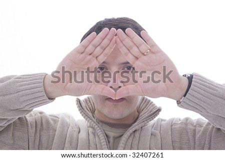 a young man playing with his hands - stock photo